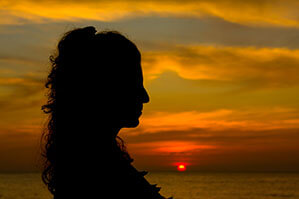Contemplative woman at sunset